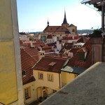 Red roofs span for miles across Prague's vast landscape.