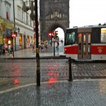 Rain douses locals and tourists on their way to Charles Bridge.