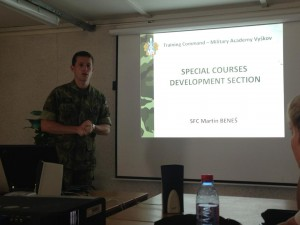 Vyskov Military Academy Special Forces Coordinator Martin Benes briefs the students on the journalist training camp. He played videos of the crisis situations the journalists encounter during training, in which he says he plays several roles. Benes joked that the military officials who act in the training course are better than Hollywood actors.