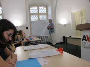 Anglo-American University teacher giving a crash course on speaking the Czech language.  Some students' nerves were calmed after they received some basic knowledge regarding the Czech language from the instructor.