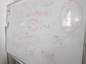 Dry erase board in Czech language class at Anglo-American University.  The instructor teaching the students about the Czech language uses written language to demonstrate how the words sound. Photo by Mary Betz.