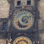 The Astronomical Clock in Old Town Square. Crowds gather every hour on the hour to watch a performance by the mechanical Twelve Apostles. The clock, which dates back to the 15th century, displays the zodiac signs as well as the time of day.